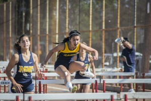 MOOR photo by AAQIL KHAN LEAP OF FAITH Varsity 110 hurdler Jessie Weng competes against Montebello on April 13. Alhambra girls' varsity track and field team remains undefeated, with their next meet on April 20 against Bell Gardens.